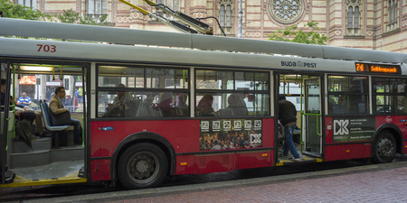 Passengers in a trolley bus, Budapest, Hungary Redactioneel