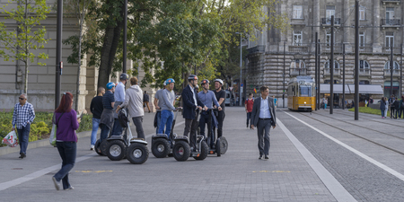 People standing on road with segway scooters, Budapest, Hungary