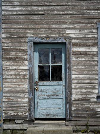 Closed exterior door of wooden building, Slocan Park, British Columbia, Canada
