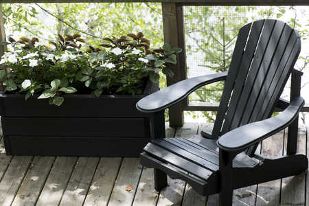 Adirondack chair on a deck, Kenora, Lake of the Woods, Ontario, Canada Stockfoto