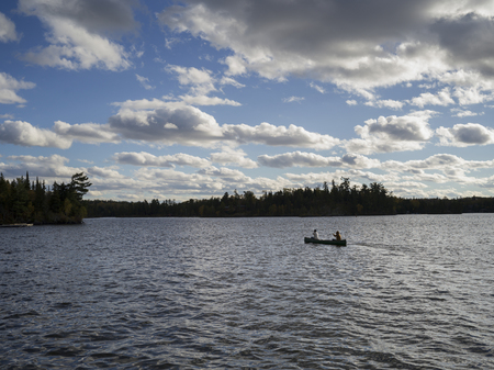 People rowing a canoe in a lake, Kenora, Lake of the Woods, Ontario, Canada