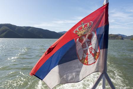 Flag of Serbia on the deck of a boat Danube River, Svinita, Mehedinti County, Oltenia, Romania