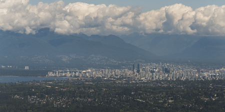 Aerial view of Vancouver with mountain range in the background, Vancouver Island, British Columbia, Canada