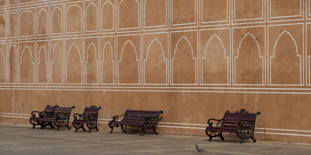 Empty benches in front of wall, City Palace, Jaipur, Rajasthan, India