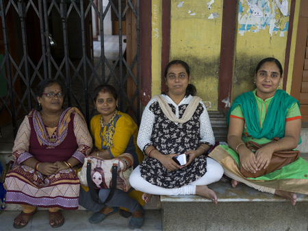 Portrait of four women sitting together, Abhedananda Road, Kolkata, West Bengal, India Editorial