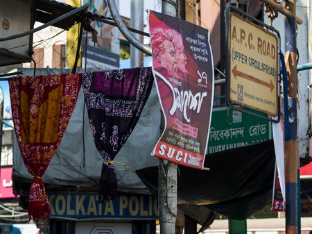 Signboards and posters in street, Kolkata, West Bengal, India Stock Photo - 118184635