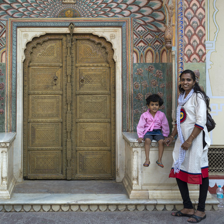 Woman and her daughter at peacock gate in City Palace, Jaipur, Rajasthan, India Editorial