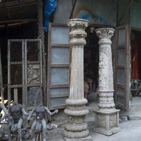 Incomplete statues and ornate columns, Kumartuli, Kolkata, West Bengal, India