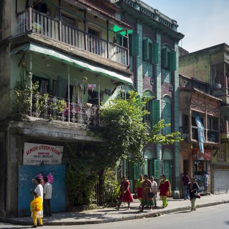 People walking on sidewalk, Kolkata, West Bengal, India