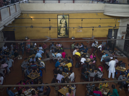 High angle view of people in a historic coffee house, Indian Coffee House, College Street, Kolkata, West Bengal, India