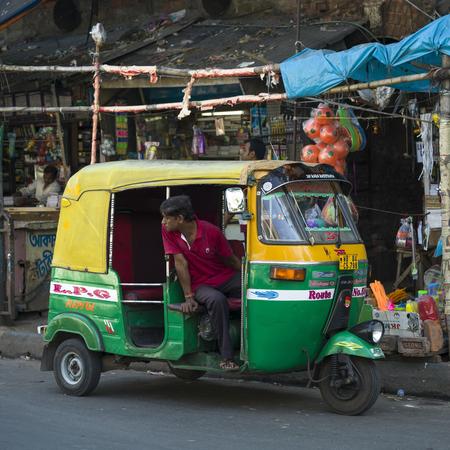 Auto rickshaw on street, Kolkata, West Bengal, India