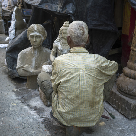 Artist working on an idol of Lord Shiva, a Hindu God, Kumartuli, Kolkata, West Bengal, India Editorial