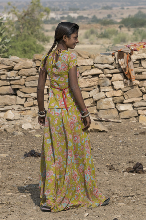 Rear view of a tribal woman, Jaisalmer Fort, Jaisalmer, Rajasthan, India