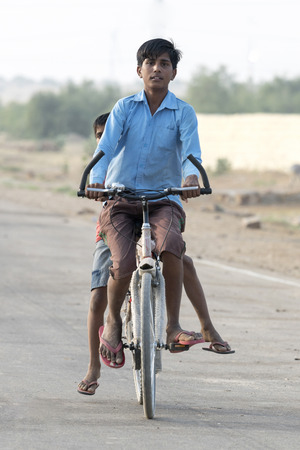 Boys riding bicycle, Kahla, Thar Desert, Rajasthan