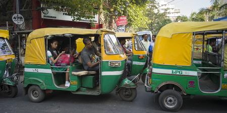 Auto rickshaws on street, Kolkata, West Bengal, India