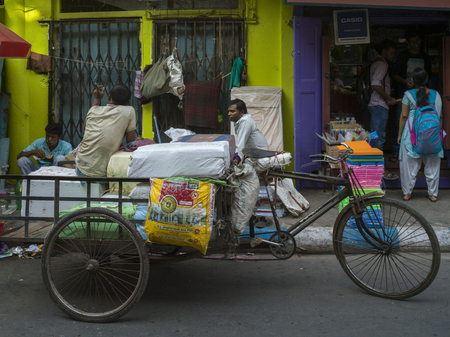 Loaded rickshaw in front of a store, Kolkata, West Bengal, India