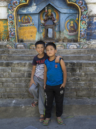 Two boys standing in front of Buddhist temple, Kaluk, Sikkim, India