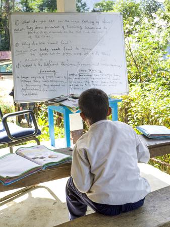 Schoolboy in classroom, Radhu Khandu Village, Sikkim, India Редакционное