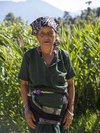 Native woman standing in a field, Sangadorji, Sikkim, India