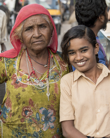 Happy girl standing with her grandmother, Jaisalmer, Rajasthan, India Editorial