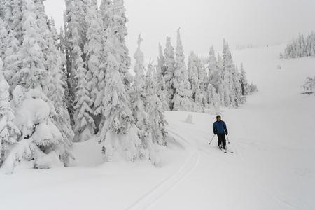 Tourist skiing in Sun Peaks Resort, Sun Peaks, Kamloops, British Columbia, Canada