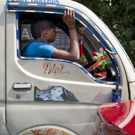 Man driving a truck, Kolkata, West Bengal, India