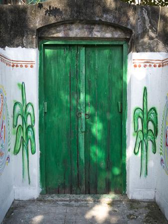 Close-up of closed green door, Kolkata, West Bengal, India