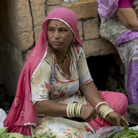 Native woman selling vegetables, Jaisalmer Fort, Jaisalmer, Rajasthan, India Editorial