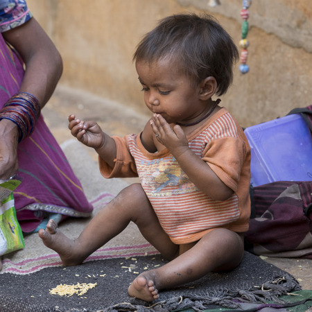 Close-up of toddler eating snacks, Jaisalmer Fort, Jaisalmer, Rajasthan, India