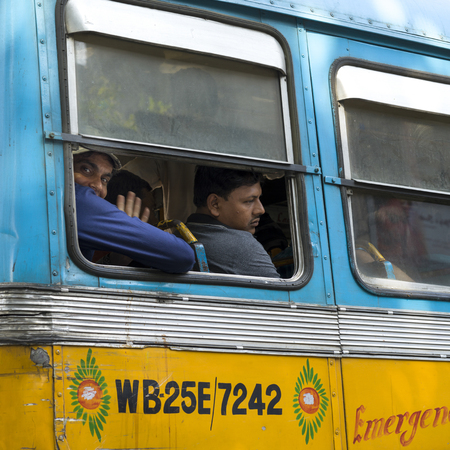 People traveling in bus, Kolkata, West Bengal, India Stock Photo - 120229404