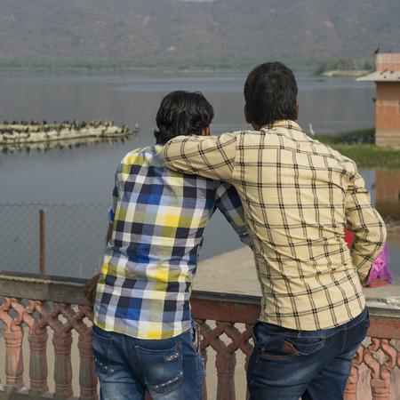 Tourists looking at lake, Jal Mahal Grand Palace, Man Sagar Lake, Jaipur, Rajasthan, India