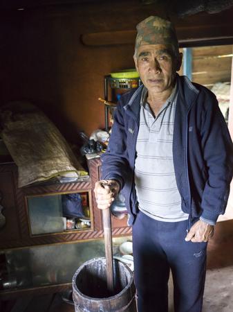 Man making rice beer, Sikkim, India