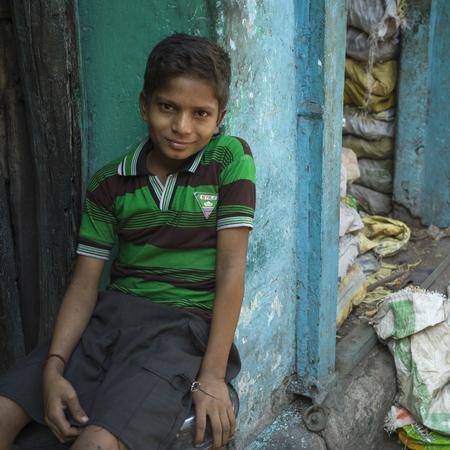Portrait of a smiling boy, Kolkata, West Bengal, India Редакционное