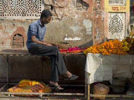 Man selling garlands near temple, Jaipur, Rajasthan, India Editorial