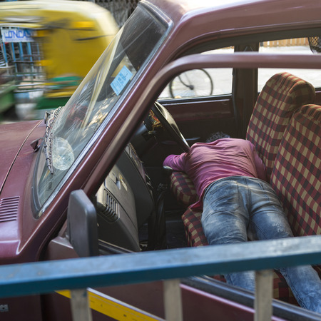 Man resting in car, Abhedananda Road,, Kolkata, West Bengal, India