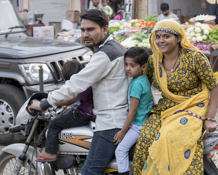 Couple with their children riding motorcycle, Jaisalmer, Rajasthan, India