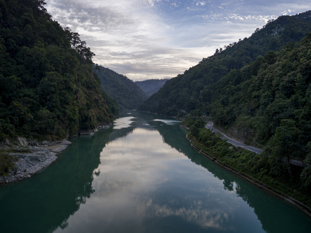 Reflection of clouds in Teesta River, Mangber Forest, Sikkim, India
