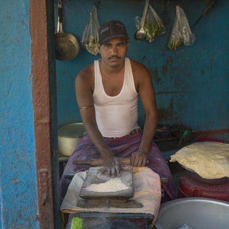 Man making chapatti (Flatbread), Kolkata, West Bengal, India