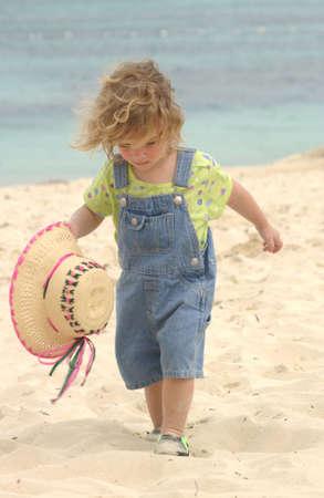 Child walking on beach photo