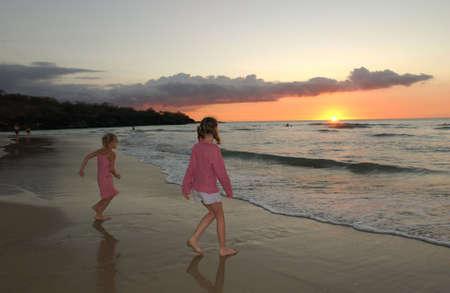 children  play: Kids playing on beach - Hawaii Stock Photo