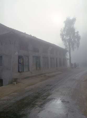 Building in Fog - Nepal photo