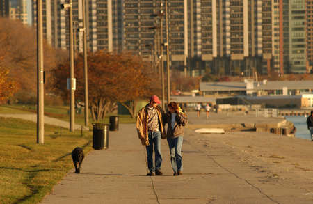 lakeshore: Couple walking together by Lakeshore Drive Stock Photo