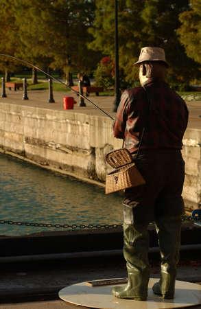 deceptive: Statue of a man fishing at an amusement park at Navy Pier