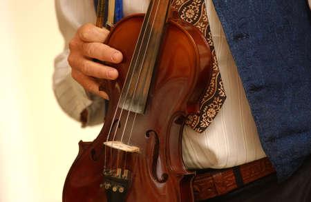 unknown age: Person holding a violin, Havana, Cuba Stock Photo