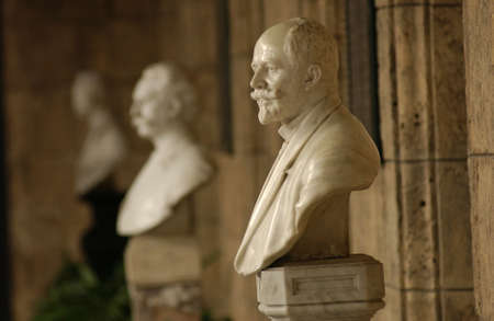 busts: Display of marble busts in a building, Havana, Cuba Stock Photo