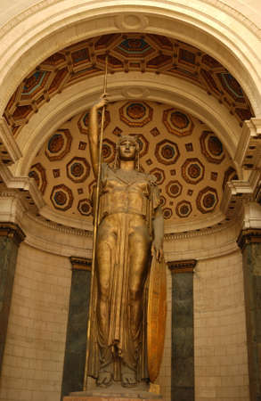 female likeness: Low angle view of a golden statue mounted inside a building, Havana, Cuba Stock Photo