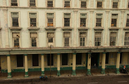 unknown age: View of the facade of a dilapidated commercial building, Havana, Cuba