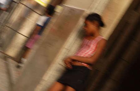 cuba girl: Young girl standing in doorway, Havana, Cuba Stock Photo