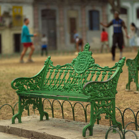 unknown age: A park bench with people in the background, Havana, Cuba