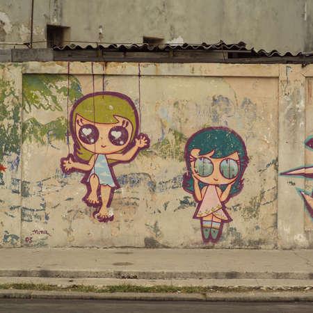 havana: Drawing of two girls on a wall, Havana, Cuba